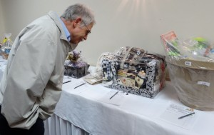 1 Marty Silverman at a silent auction table