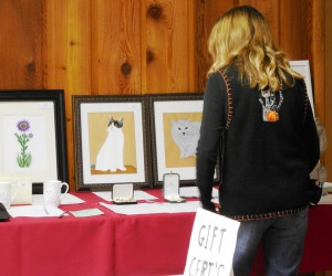 Attendee viewing some silent auction items